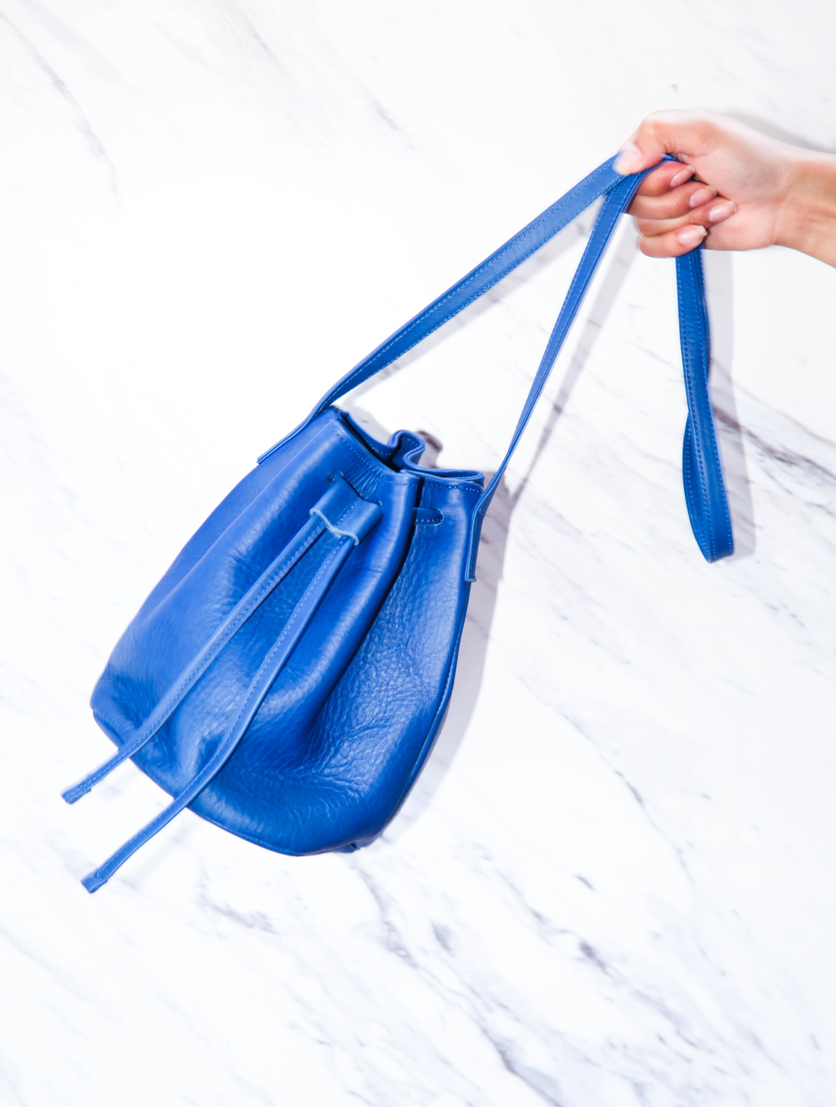 blue leather duffle bag